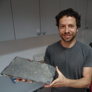 Zachi Dvira holding a paving stone from Herod's Temple. This piece of bituminous limestone was smoothed by millions of Jewish pilgrims who visited the Temple in the First Century AD. Yeshua of Nazareth may have stepped foot on this very paving stone.