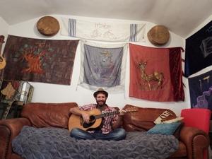 """Yitzchok Meir playing his song """"Here We Are"""" for Nehemia Gordon on Hebrew Voices. Photo by Nehemia Gordon"""